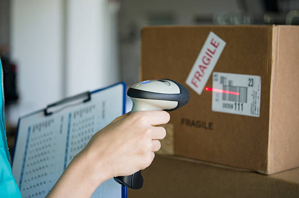 Scanning boxes with barcode scanner stock photo