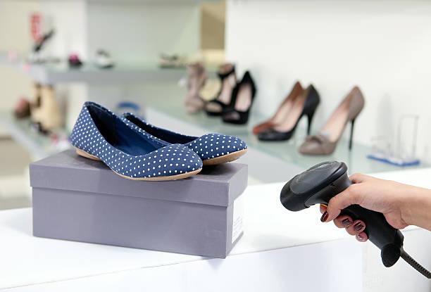 Scanning code on shoe box stock photo