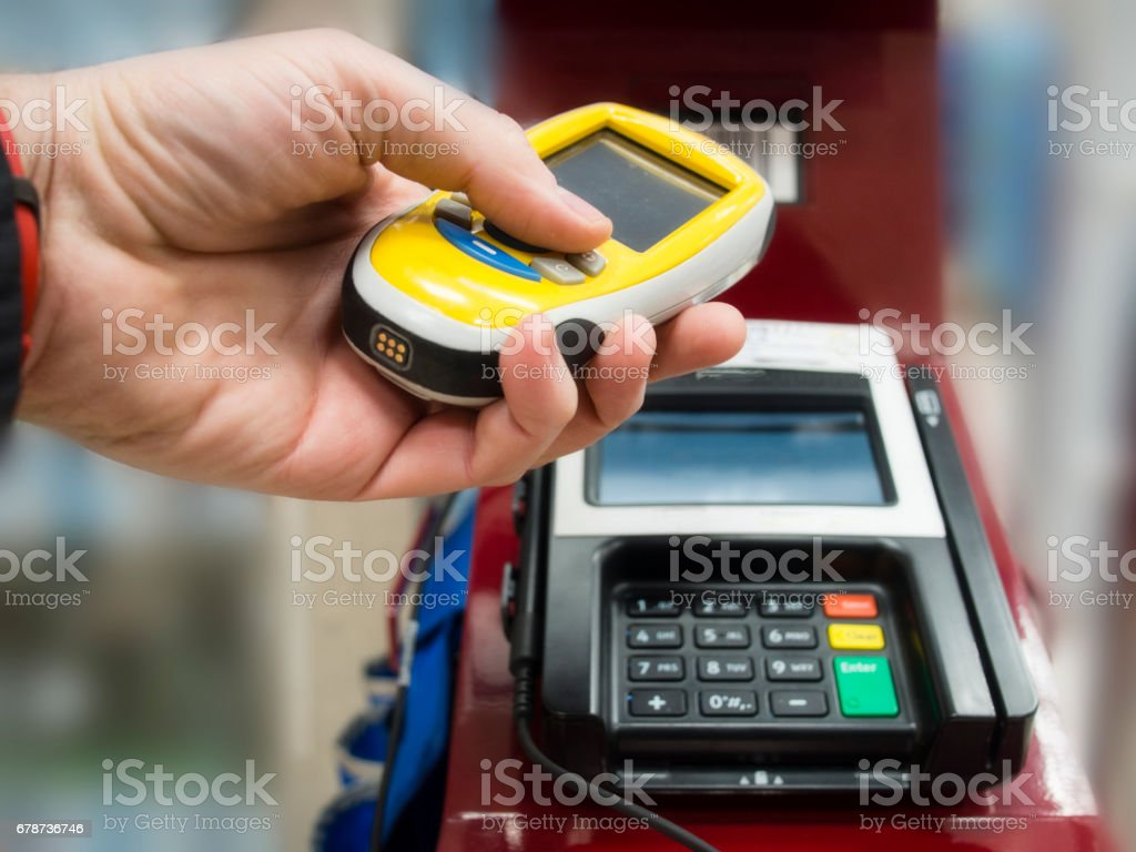 Scanning device for grocery and shopping, check out and paying time on self service counter. royalty-free stock photo
