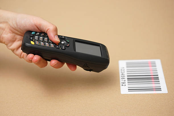 Scanning label on the box with barcode scanner stock photo