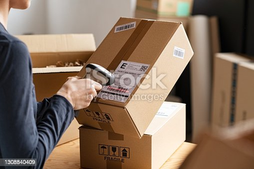 istock Scanning parcel barcode before shipment 1308840409