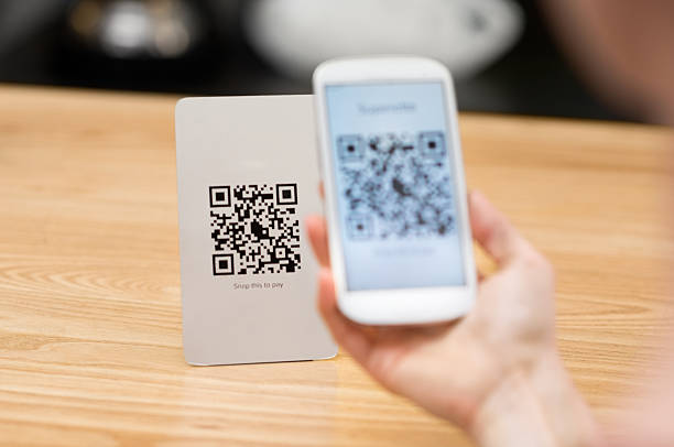 scanning qr code - contactless payment stock pictures, royalty-free photos & images