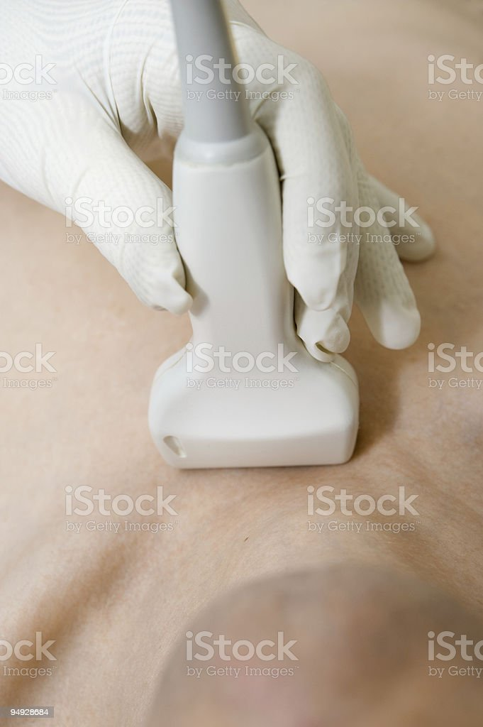 Scanning with ultrasound royalty-free stock photo