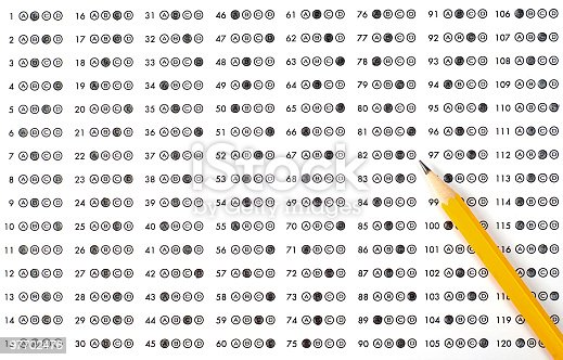 istock A scantron answer sheet with a pencil and bubbled answers 97702476