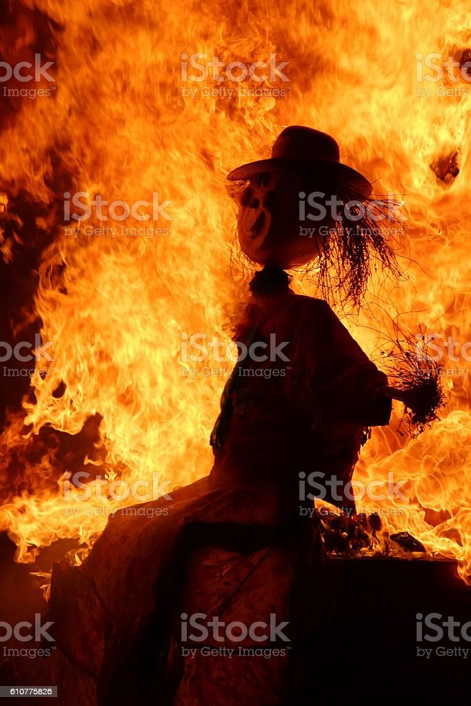 scarecrow on fire stock photo