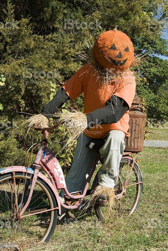 Scarecrow Riding Bicycle, Halloween Pumpkin Head royalty-free stock photo