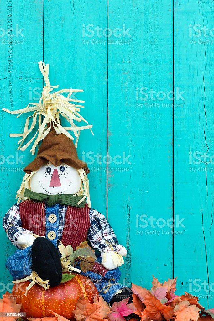 Scarecrow sitting on pumpkin stock photo