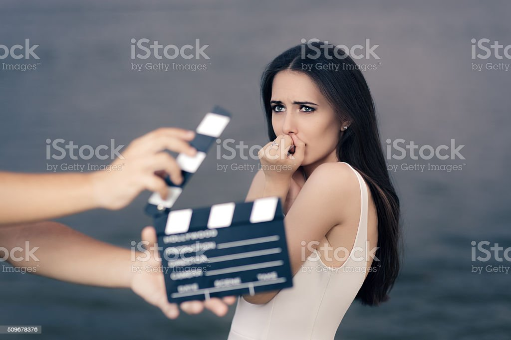 Scared Actress Shooting Movie Scene stock photo
