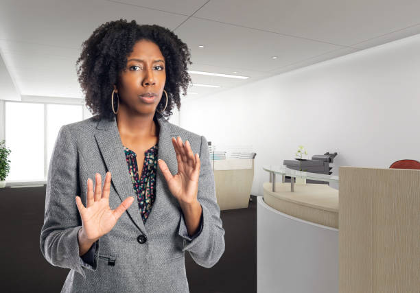 Scared African American Businesswoman in an Office stock photo