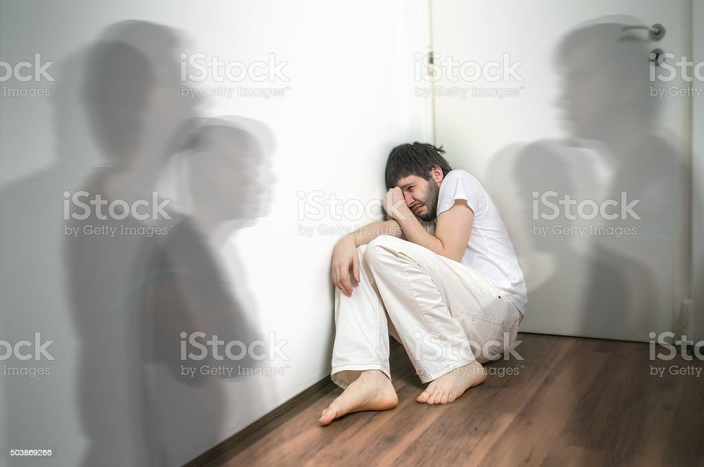 Scared and frightened man has hallucinations and sees ghosts stock photo