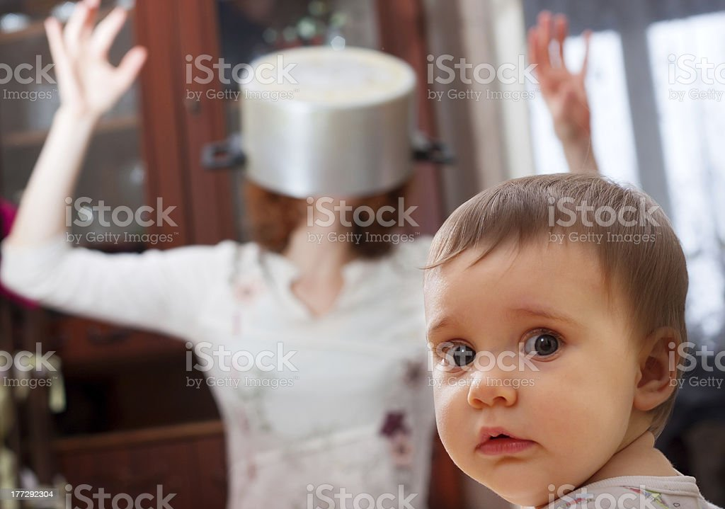 Scared baby against crazy mother stock photo