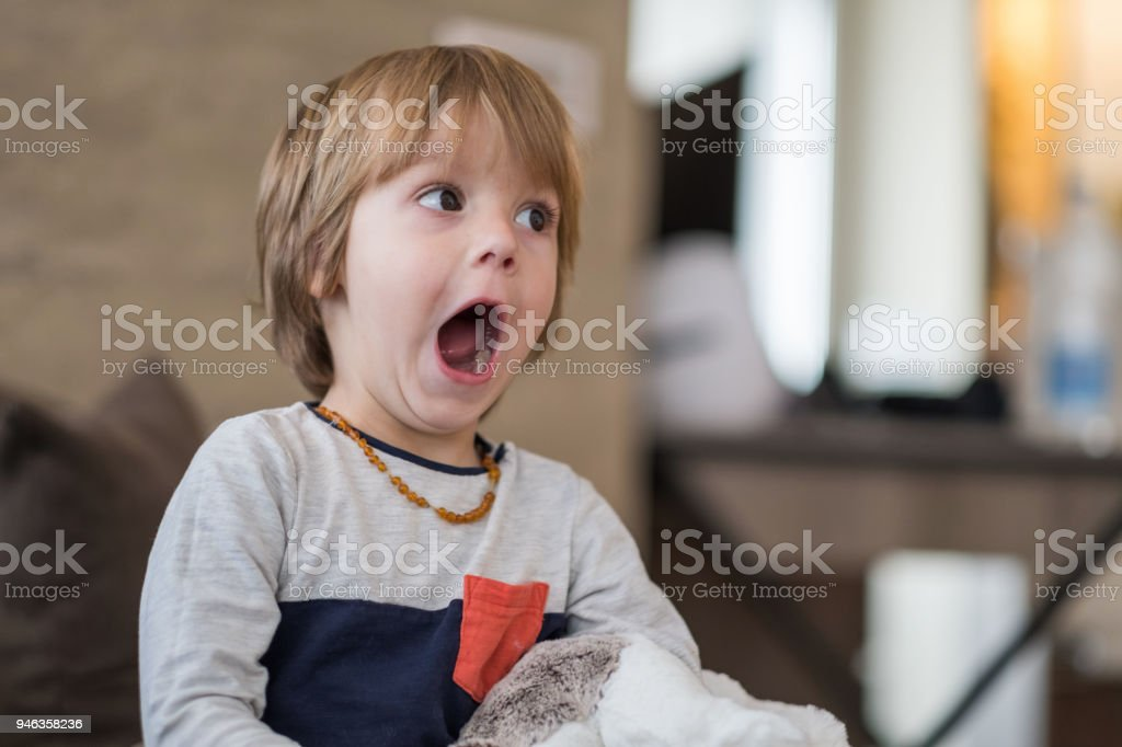 Scared boy watching TV stock photo