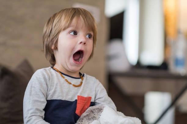 Scared boy watching TV stock photo