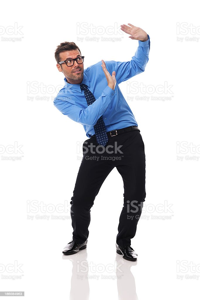 Scared businessman bending under the weight of something royalty-free stock photo