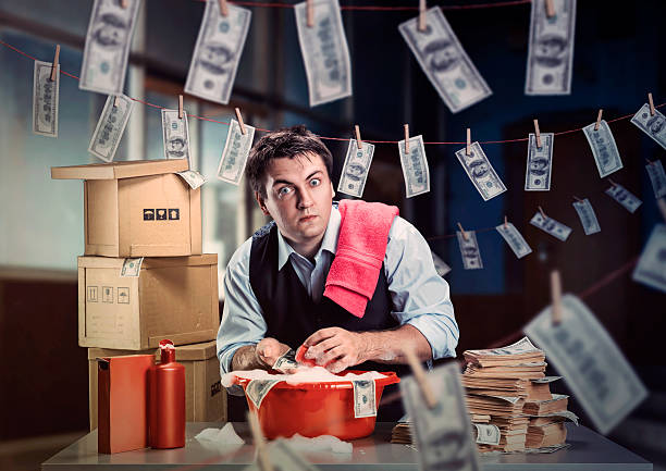 Scared businessman is laundering money stock photo