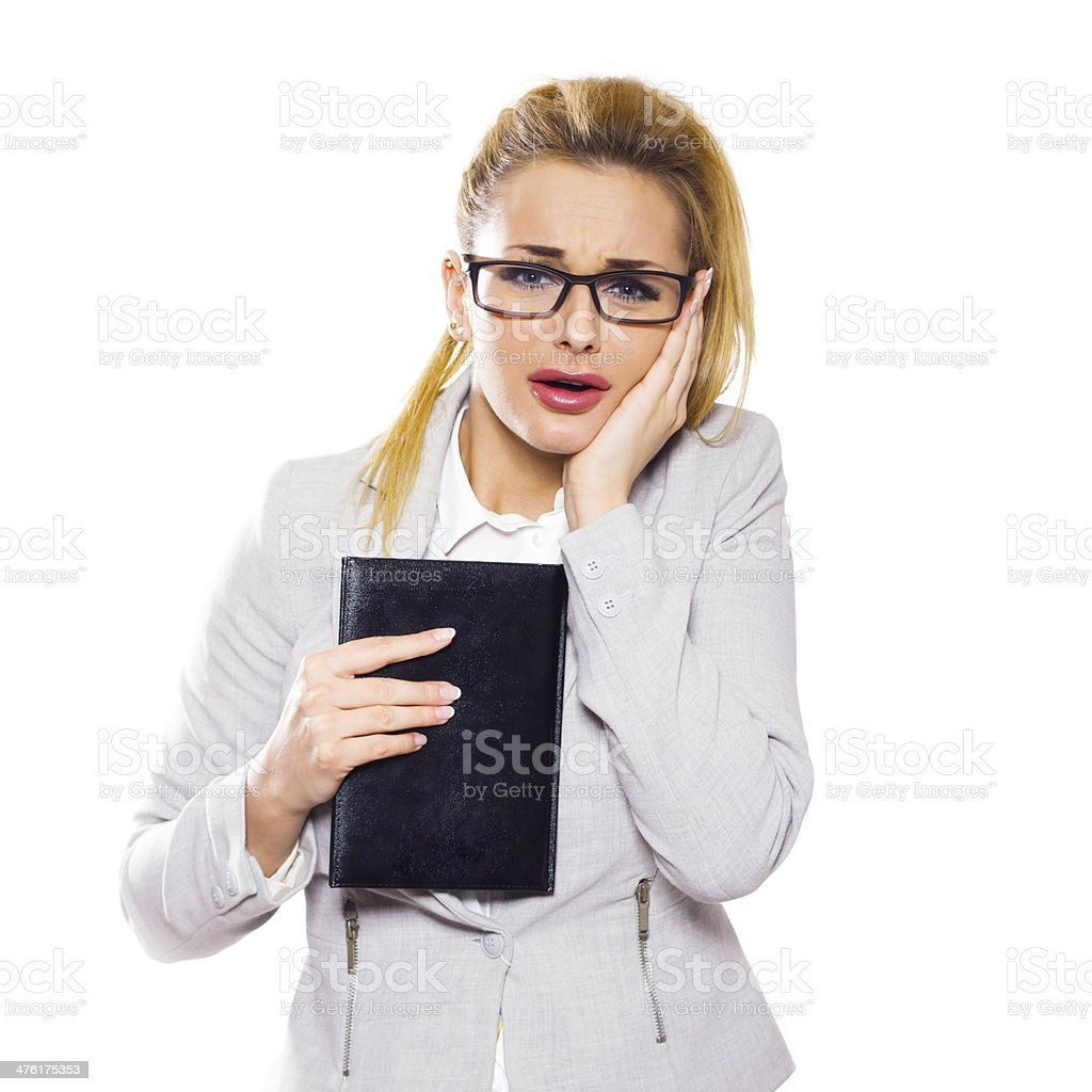 Scared businesswoman with notes. Isolated on white background. royalty-free stock photo