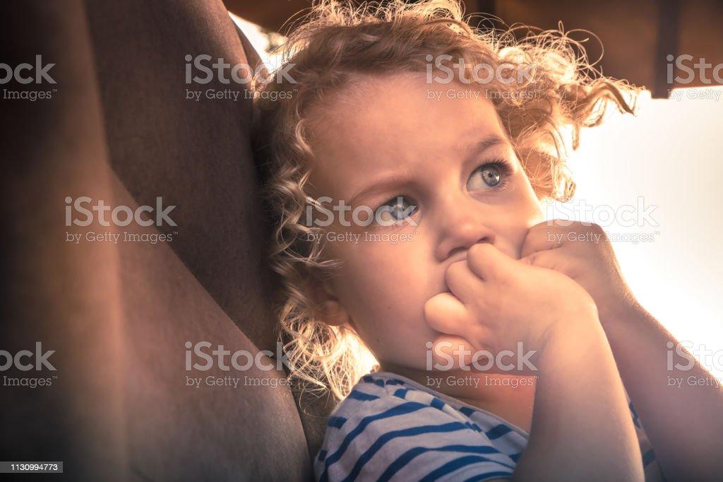 Scared child worry emotion portrait facial expression symbolizing...