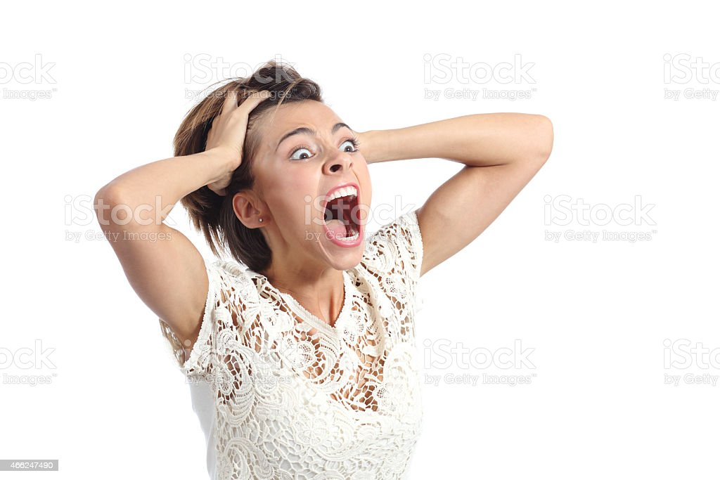 Scared crazy woman crying with hands on head stock photo