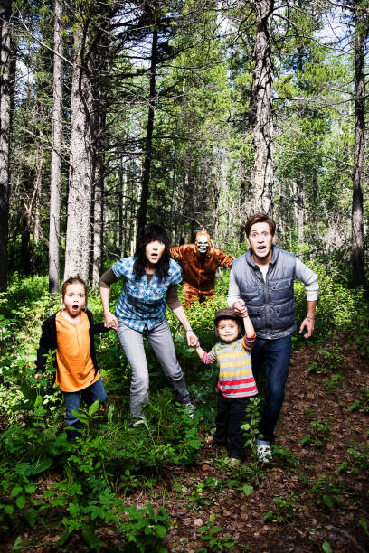Scared Family Running Away stock photo