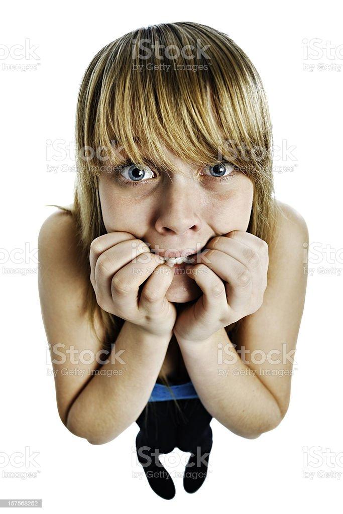 Scared female teenager bites nails royalty-free stock photo