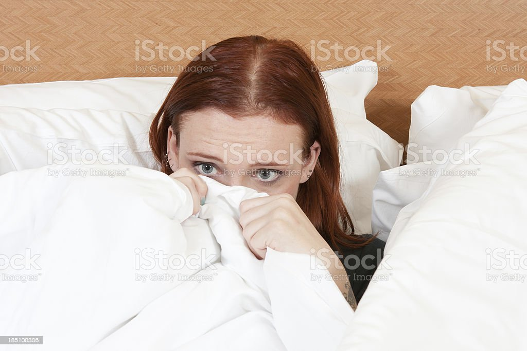 Scared in bed stock photo