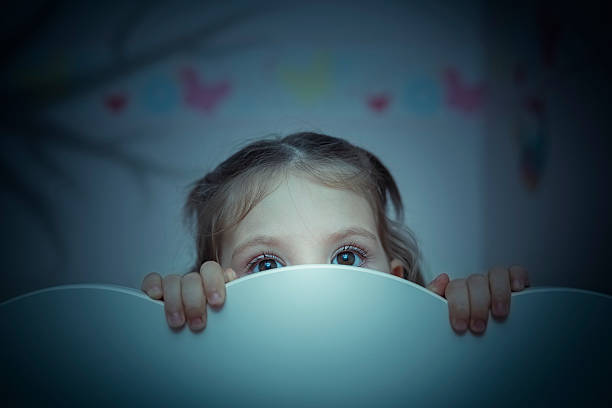 scared little girl in her bed - fear stock photos and pictures