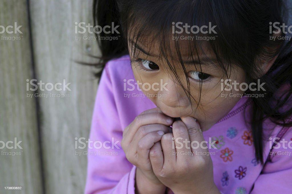 Scared little girl stock photo