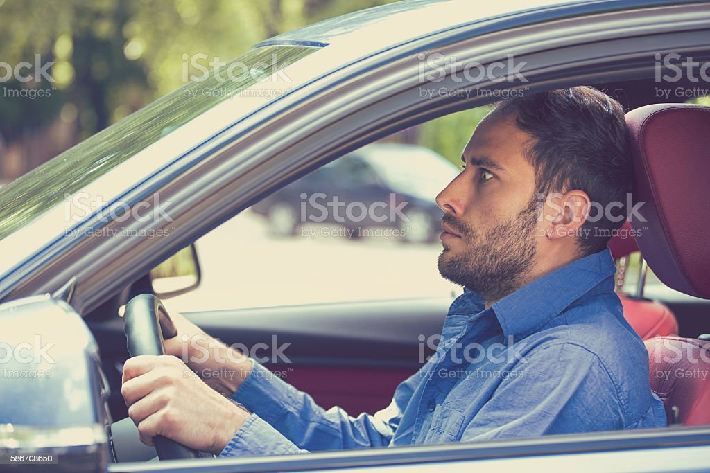 scared man driver in car. Inexperienced anxious motorist stock photo