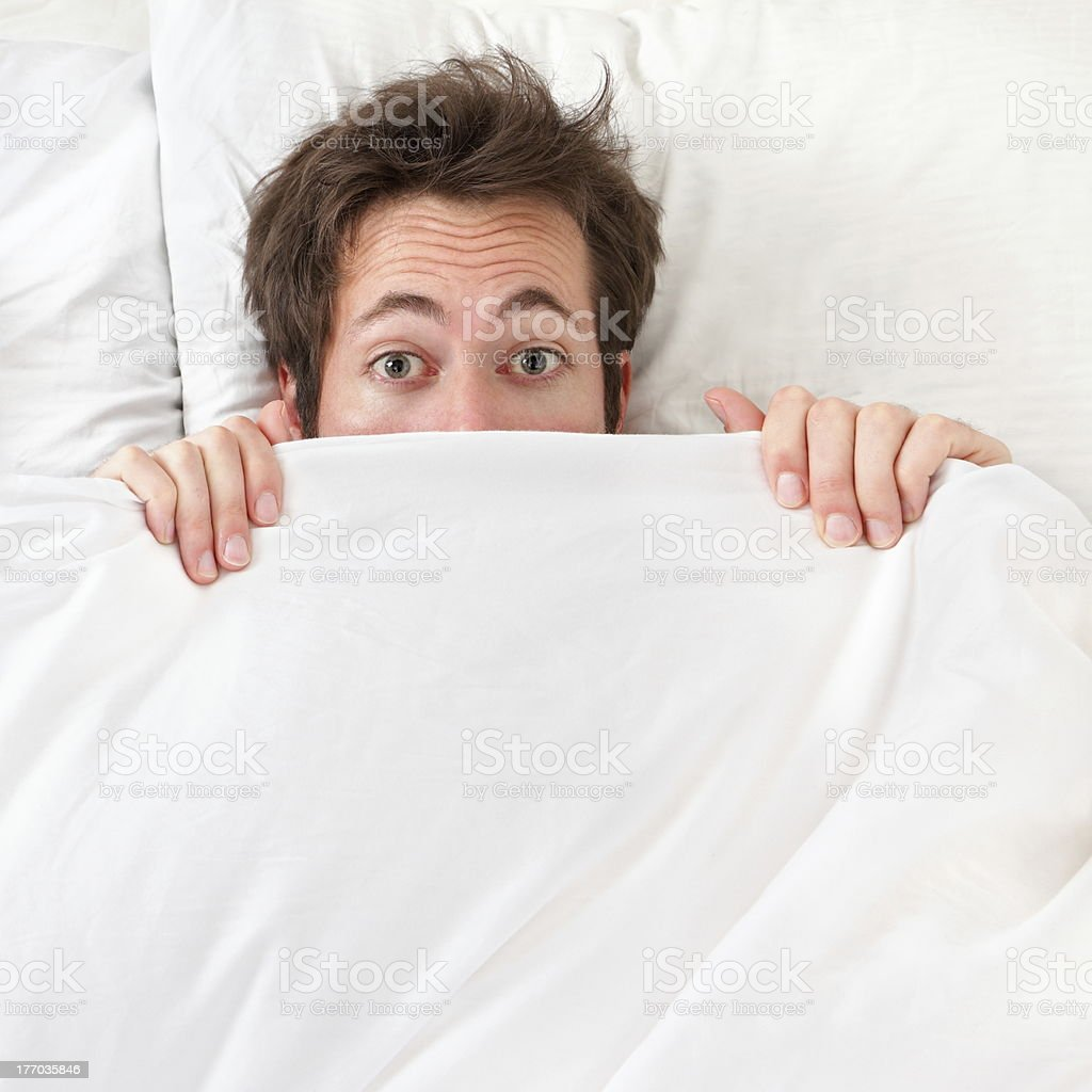 Scared Man Hiding In Bed Stock Photo - Download Image Now - iStock