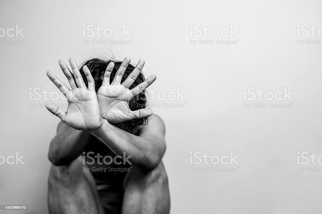 scared man lift hand up for say stop, to protect himself. anti human trafficking campaign. black and white color with copy space for campaign poster or flyer scared man lift hand up for say stop, to protect himself. anti human trafficking campaign. black and white color with copy space for campaign poster or flyer Adult Stock Photo