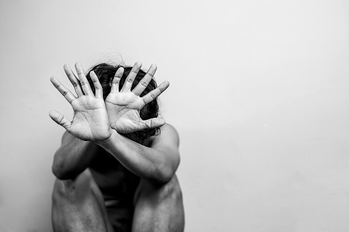 Scared Man Lift Hand Up For Say Stop To Protect Himself Anti Human Trafficking Campaign Black And White Color With Copy Space For Campaign Poster Or Flyer Stock Photo - Download Image Now