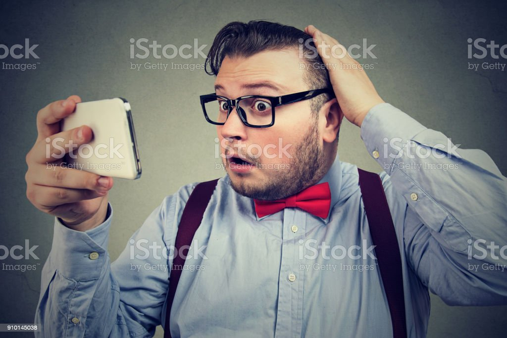 Scared man losing hair from stress stock photo