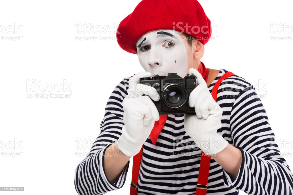 scared mime taking photo with film camera isolated on white stock photo