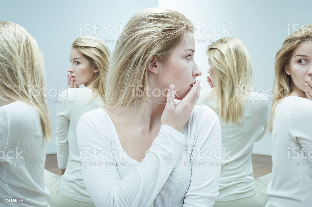 Scared of herself stock photo