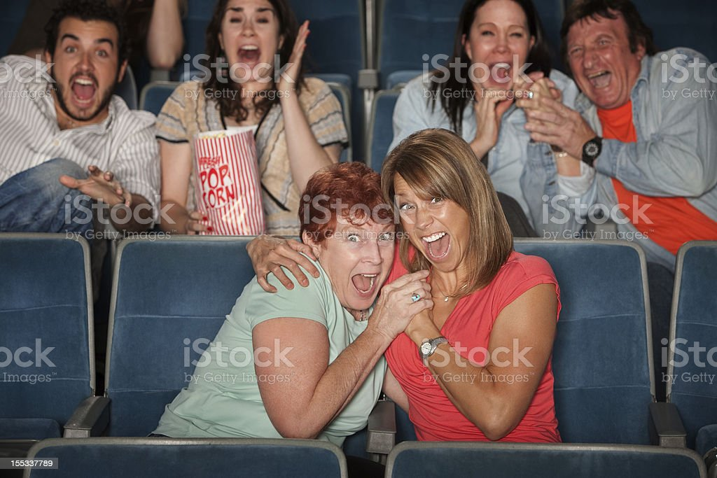Scared People Watching Movie royalty-free stock photo