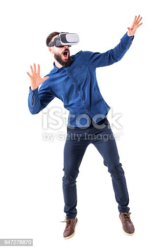 istock Scared shocked bearded adult man having virtual reality headset experience with open mouth 947278870