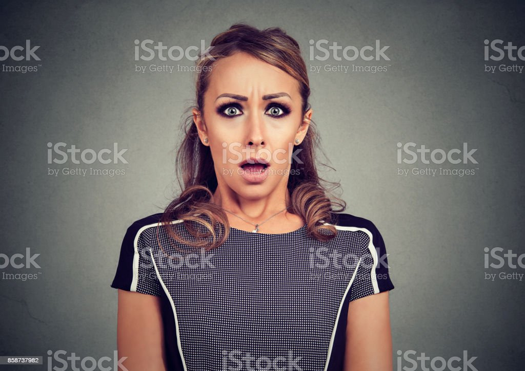 Scared shocked woman isolated on gray background stock photo