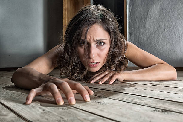 Scared woman on the floor stock photo