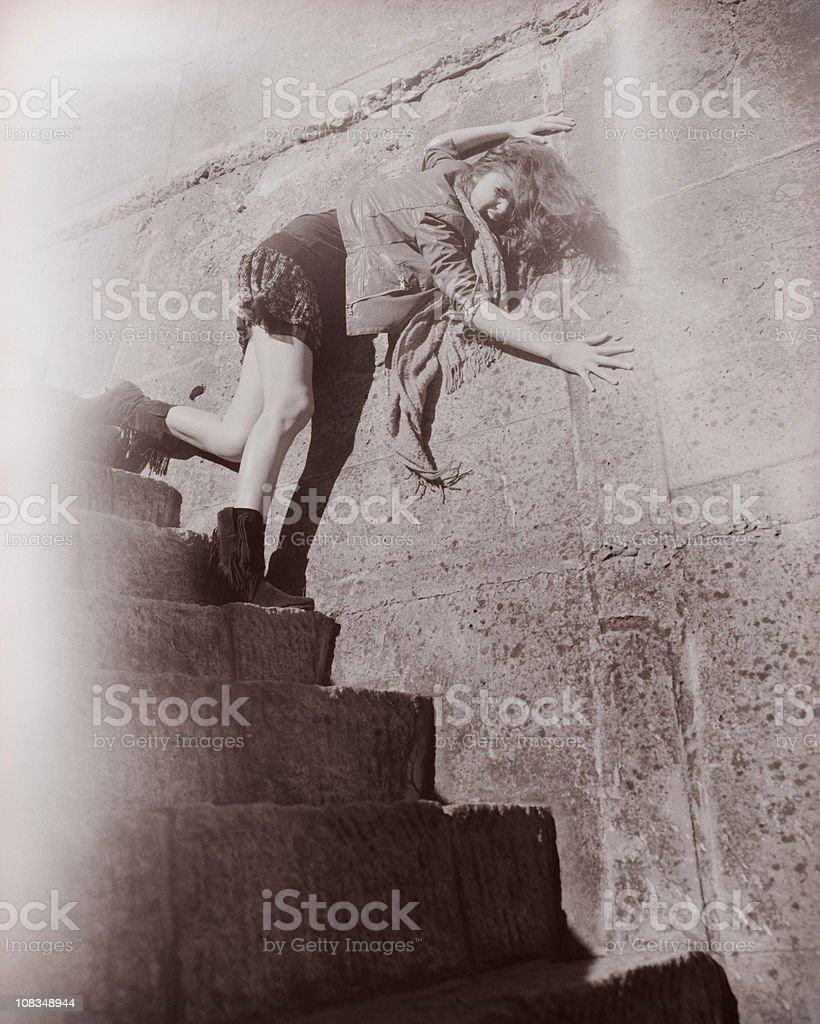 Scared woman running downstairs royalty-free stock photo