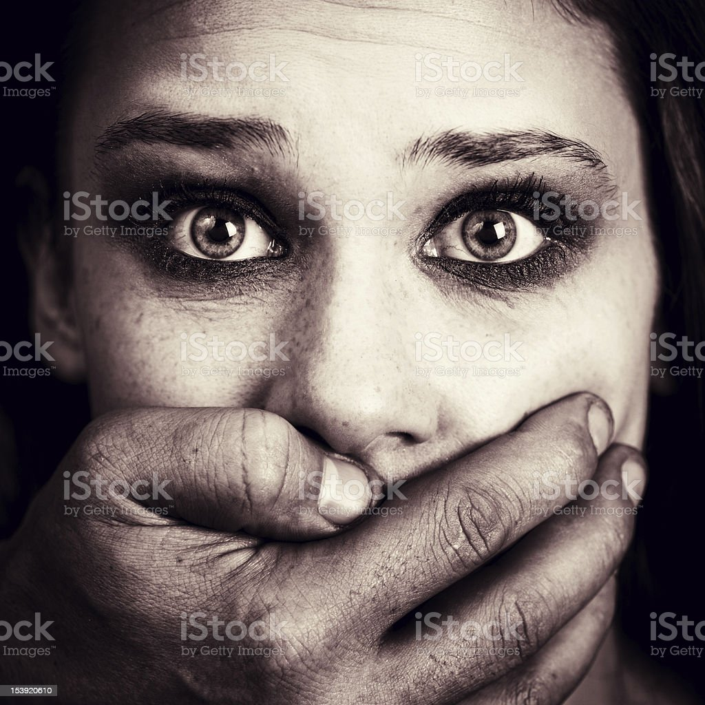 Scared woman victim of domestic torture and abuse stock photo