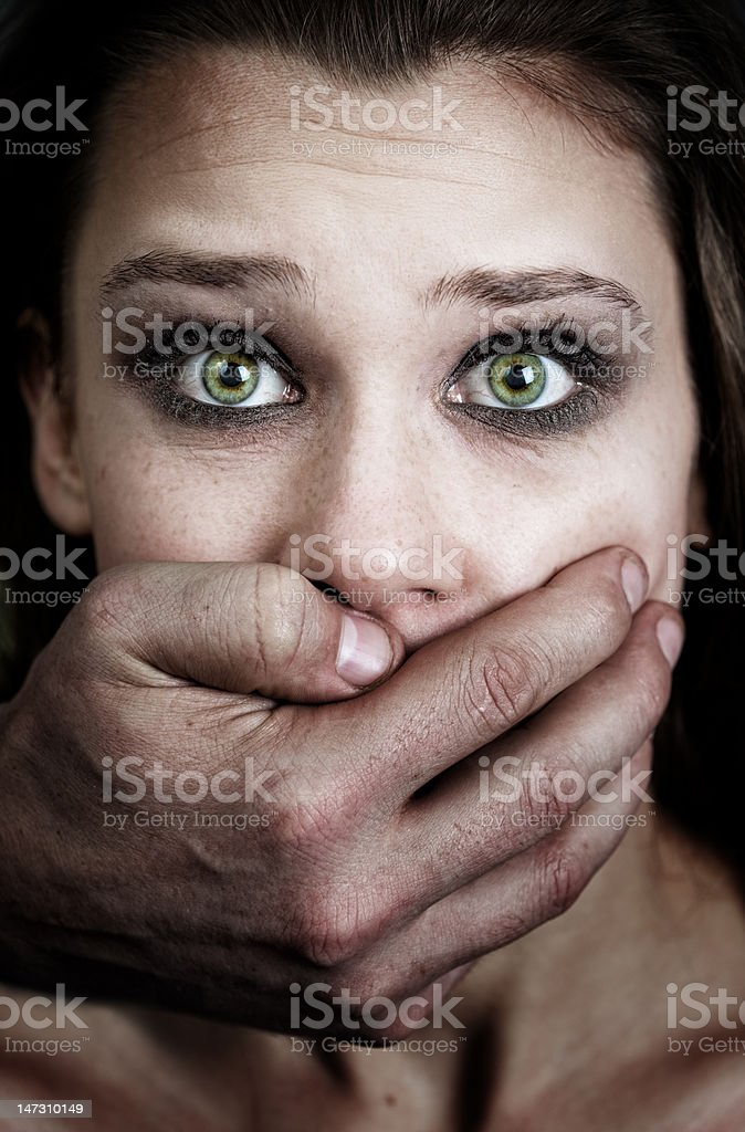 Scared woman victim of domestic violence and abuse