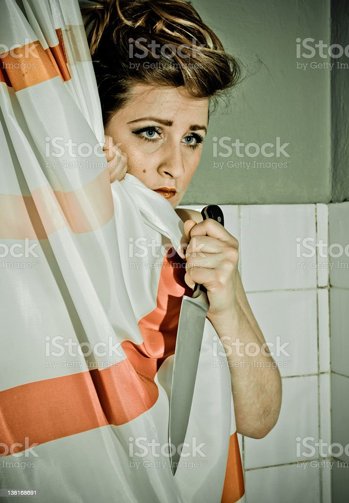 Scared woman with knife royalty-free stock photo