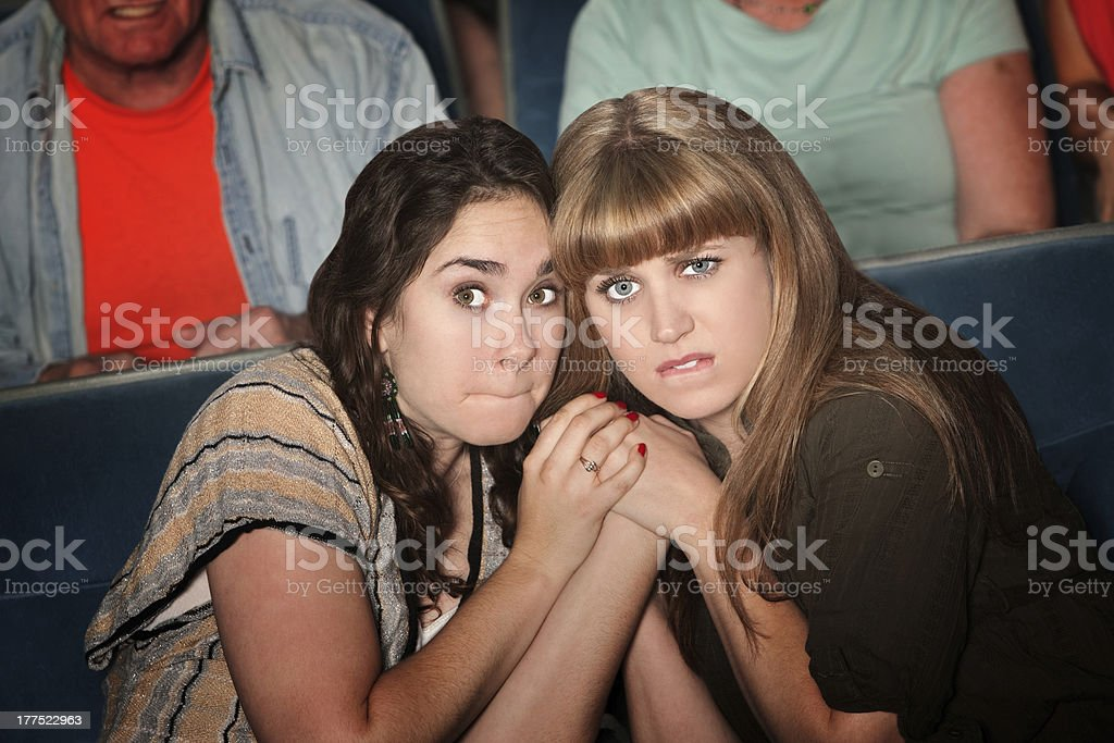 Scared Women With Clasped Hands royalty-free stock photo