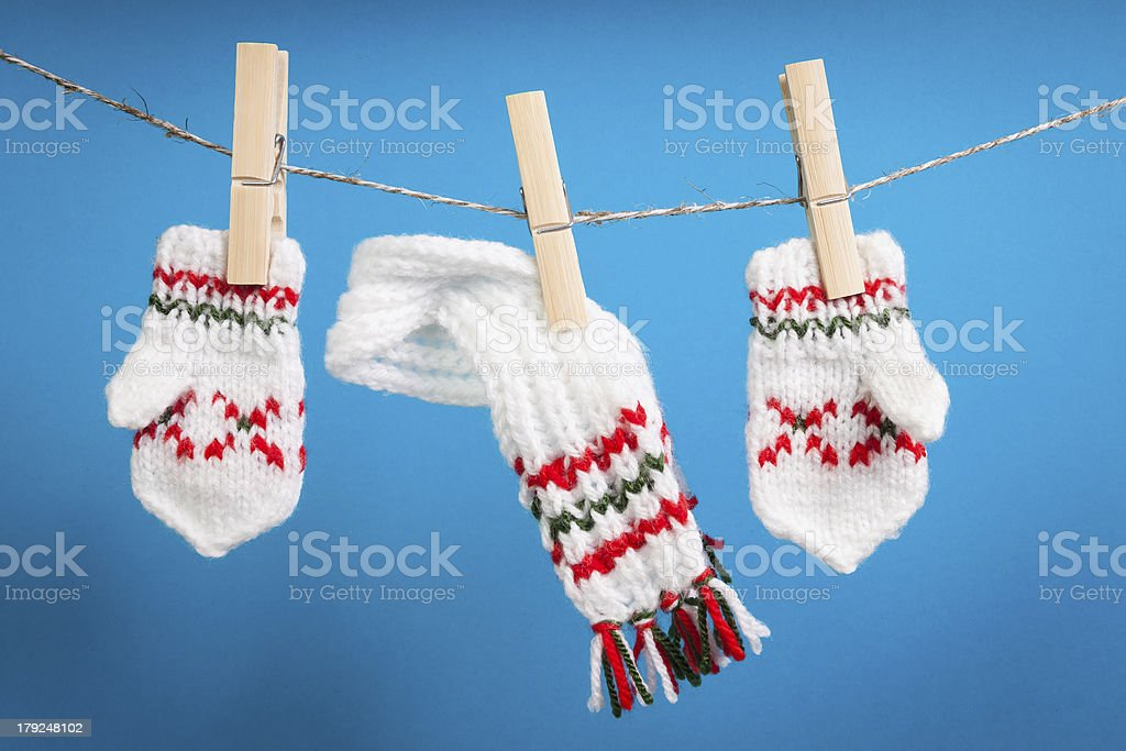scarf and pair of gloves drying royalty-free stock photo