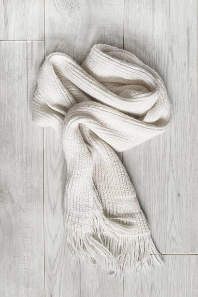 scarf on wooden background - wollschal stock-fotos und bilder