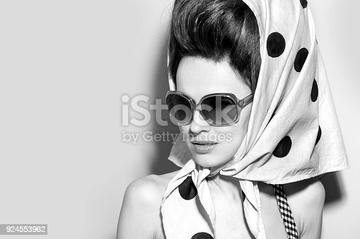 Portrait of a beautiful young woman with a scarf on her head. Ethnic look black and white