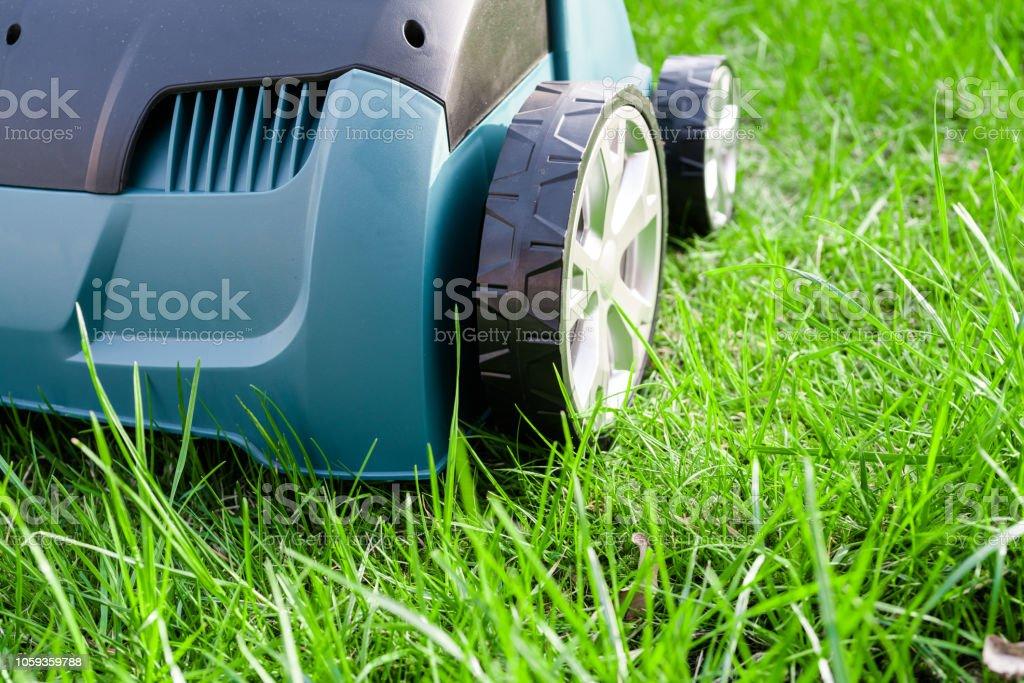 Scarifier on green grass. Work in the garden. scarifier.