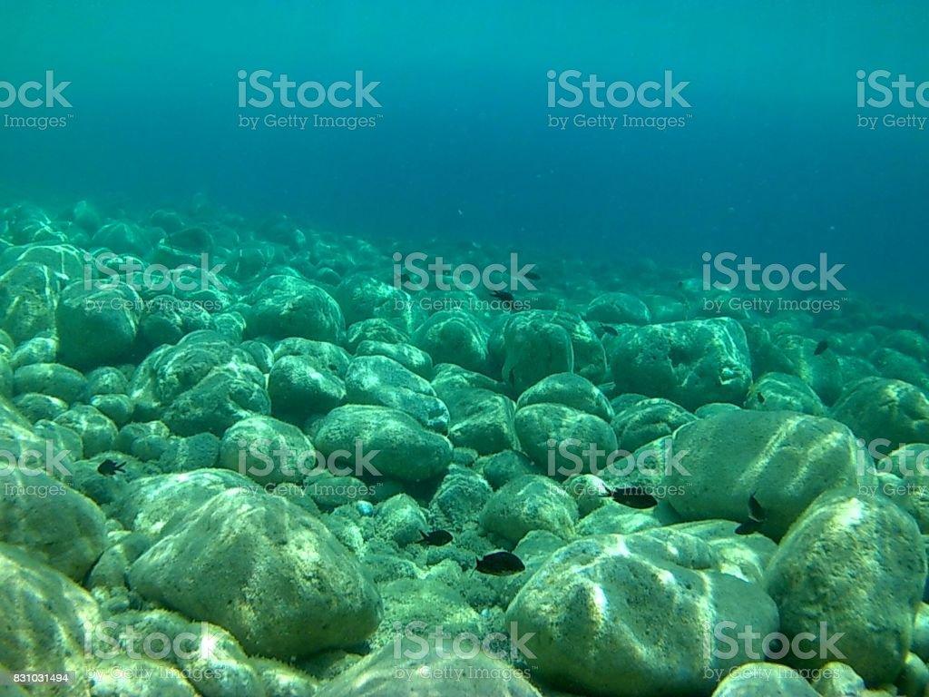 Scario - Fondale di pietre stock photo