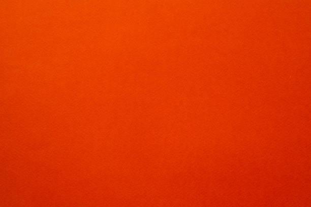 scarlet orange felt texture background fibers stock photo