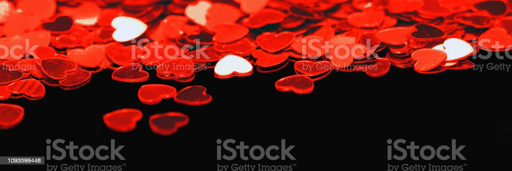 Scarlet Shiny Hearts Isolated On Black Background Panoramic View